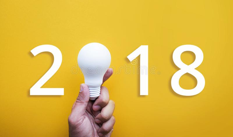 2018 Ideas creativity concept with human hand holding light bulb stock image