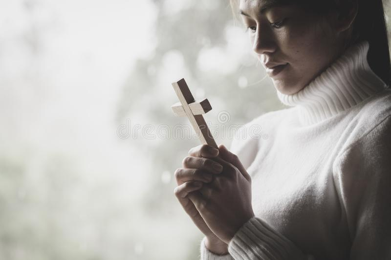 Human hand holds cross . Eucharist Therapy Bless God Helping Rep royalty free stock images