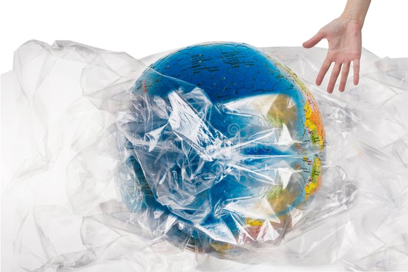 Human hand near the globe which is all in plastic, our irresponsible, excessive consumption of plastic. Human wants to save world, social advertising, world stock photos