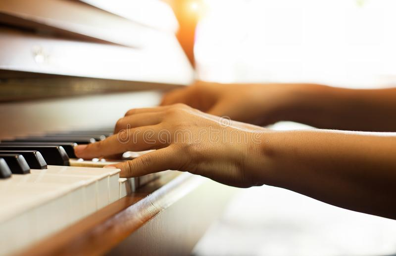 The human hand is pressing on piano keys,show how to play piano song stock photos