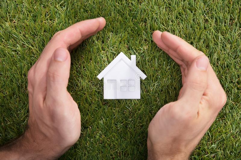 Human Hand Protecting House Model royalty free stock images