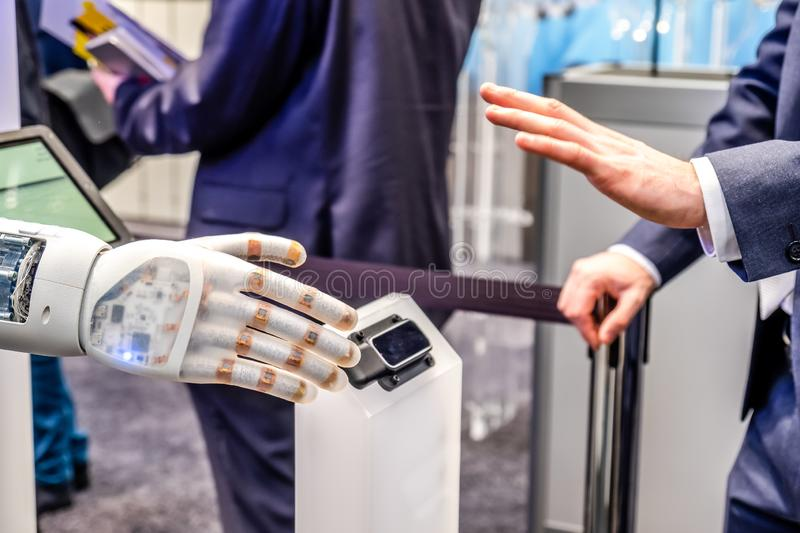 Human hand and robot`s as a symbol of connection between people and artificial intelligence technology stock photos