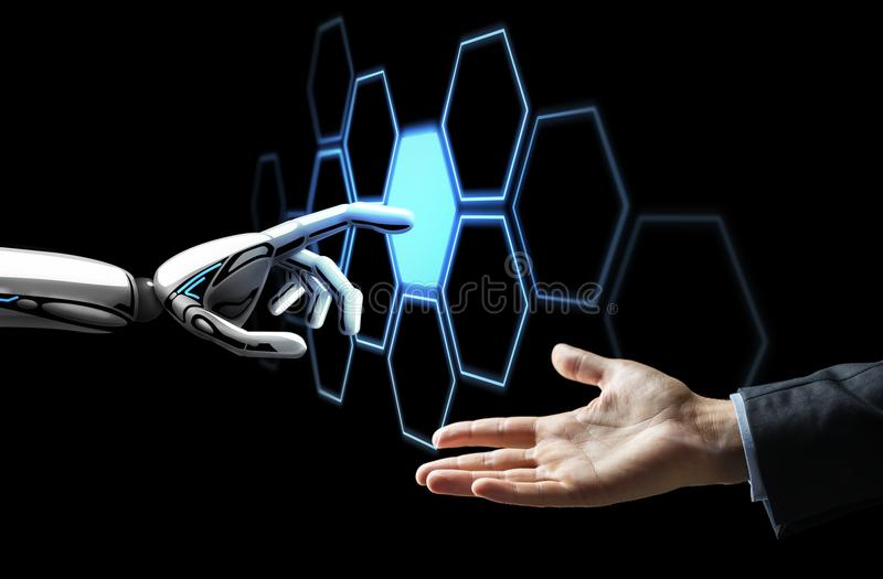 Human hand and robot touching network hologram. Future technology, artificial intelligence and business concept - human hand and robot touching virtual network stock photos