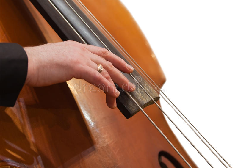 Human hand on the strings contrabass stock photo