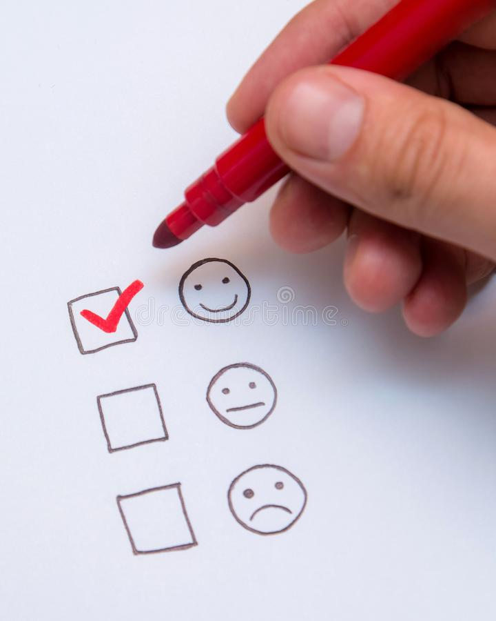 Human hand, tick placed on excellent check box. Customer service, satisfaction, survey form.  stock photography