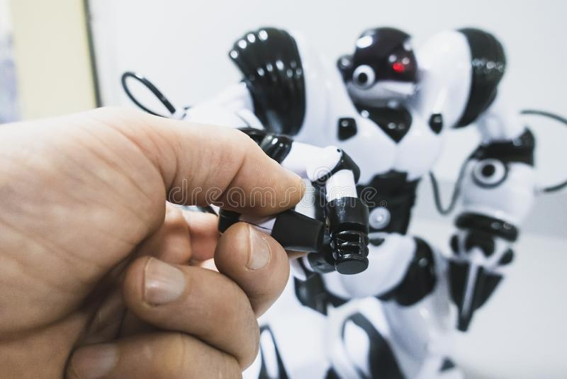 Human hand touches the robot royalty free stock photos