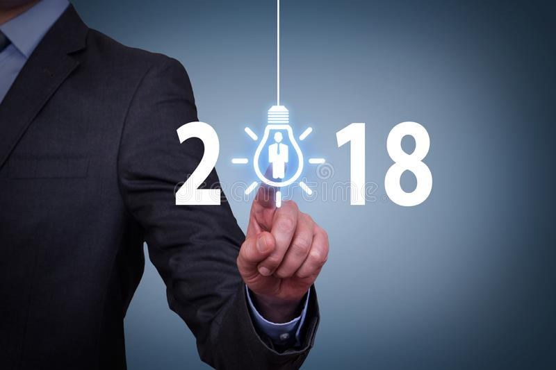 Human Hand Touching New Year 2018 Human Resources Concepts on Visual Screen. New year working stock image