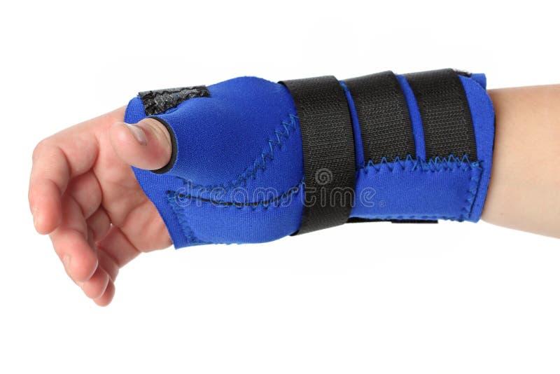 Human hand with a wrist brace stock photos