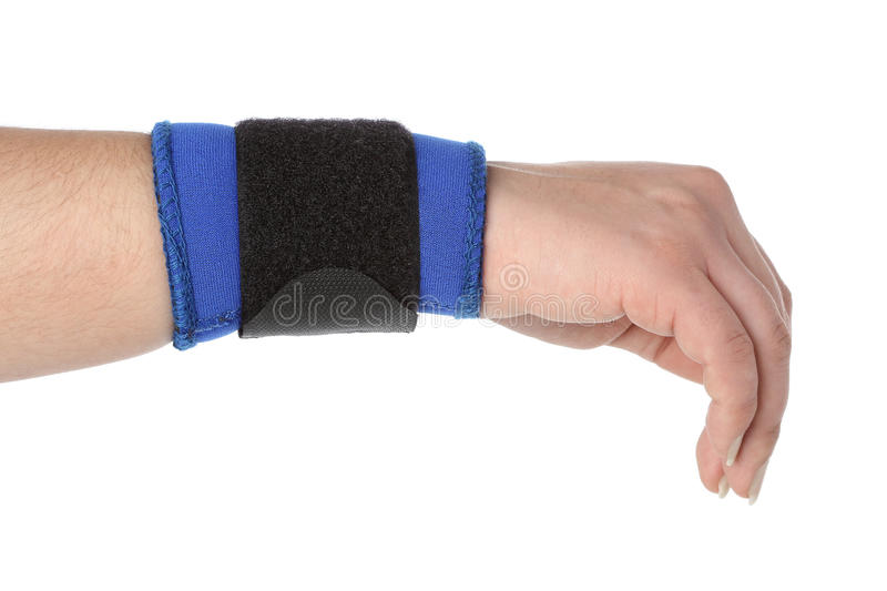 Human hand with a wrist brace royalty free stock photos