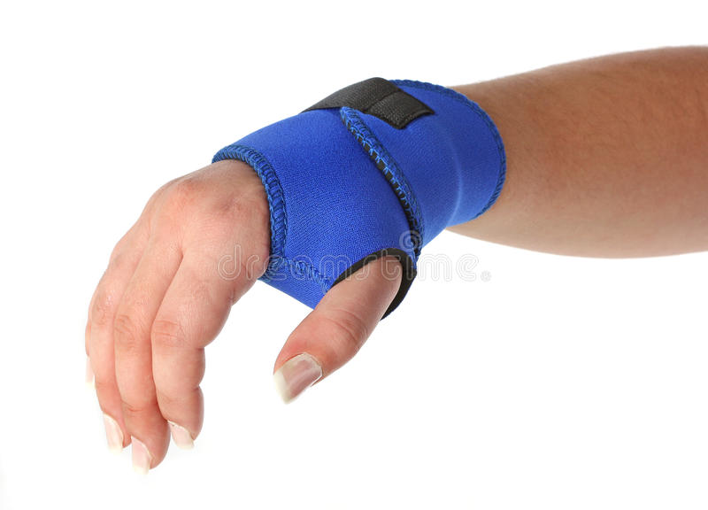 Human hand with a wrist brace royalty free stock images