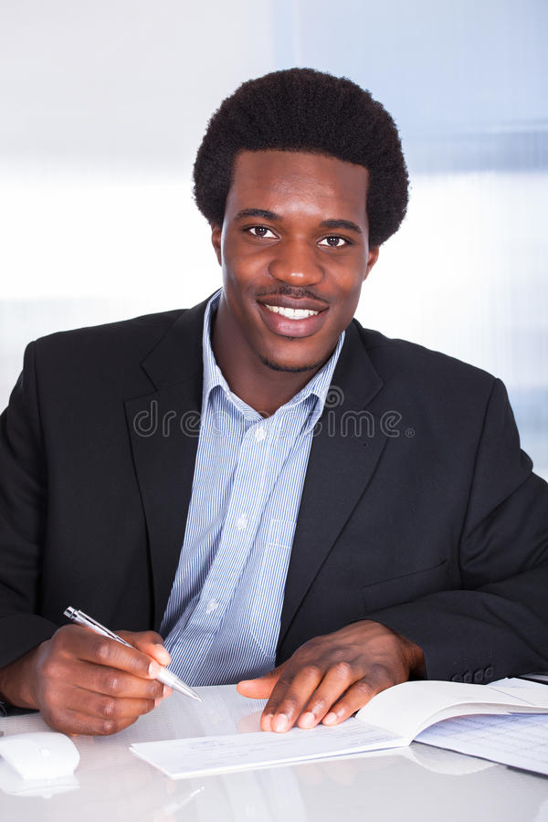 Human hand writing on cheque stock photography