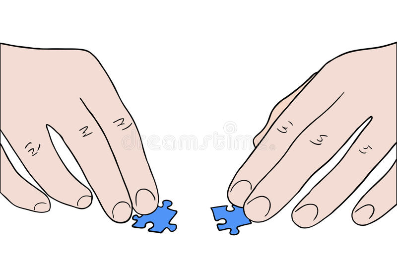 Human hands assembling two puzzle pieces