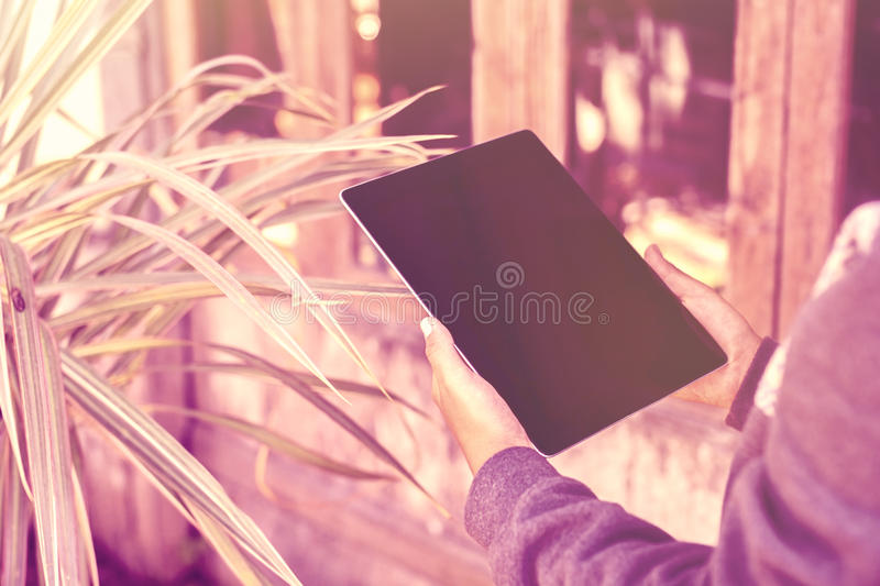 Human hands and blank digital tablet royalty free stock photo