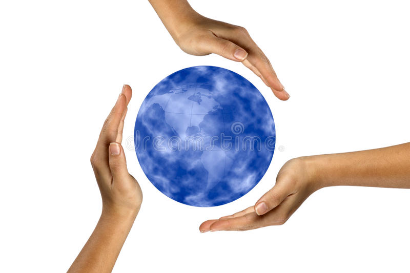 Human hands covering planet earth.