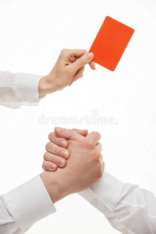 Human hands demonstrating a gesture of a strife, one hand showin. Human hands demonstrating a gesture of a strife, one hand demonstrating a red card, white royalty free stock photography