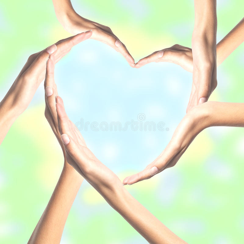 Human hands in heart shape over bright. Background royalty free stock photography
