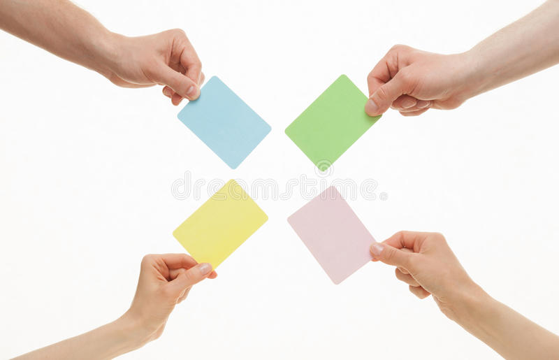 Human hands holding colorful paper cards royalty free stock photography