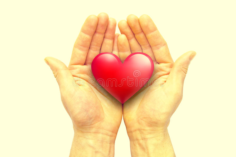 Human hands holding heart royalty free stock images