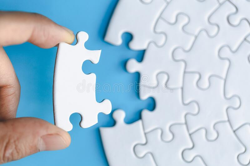 Human hands holding white jigsaw  with word problem & solution.  symbol of association and connection. business strategy stock photos