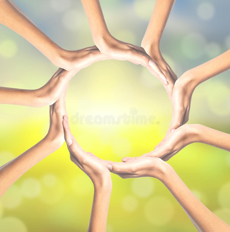 Human hands making circle on bright. Background stock photos