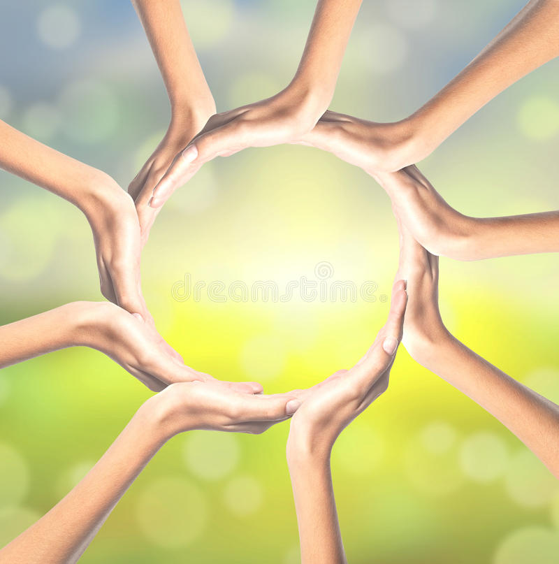 Human hands making circle on bright. Background royalty free stock photography