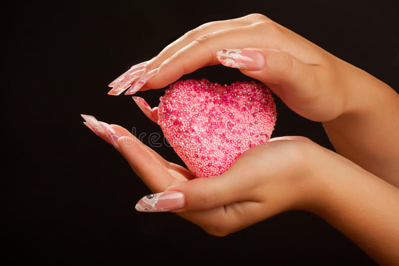 Download Human Hands With Manicure Hold Pink Heart Stock Photo - Image: 17710088