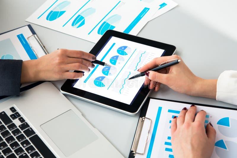 Human hands during paperwork at meeting. Image of human hands during paperwork at meeting royalty free stock image