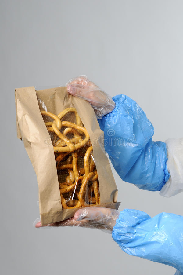 Human hands showing packing bag stock image