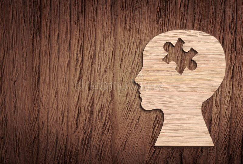 Human head silhouette with a jigsaw piece cut out royalty free stock images