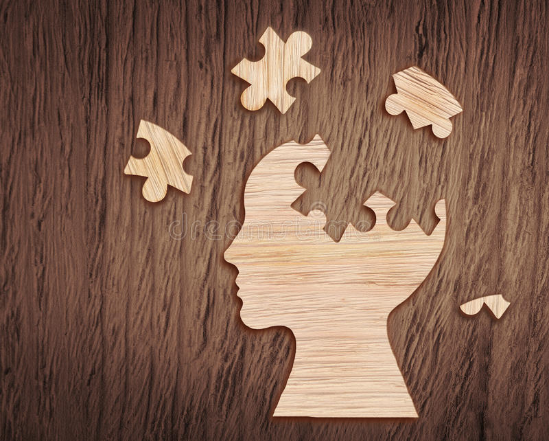 Human head silhouette with a jigsaw piece cut out stock image