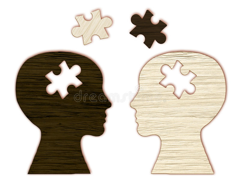 Human head silhouette with a puzzle cut out royalty free stock images