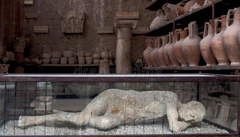 The human imprint. Remains of a person while he slept hit by the lava of Vesuvius that destroyed the entire city of Pompeii creating this human imprint royalty free stock images