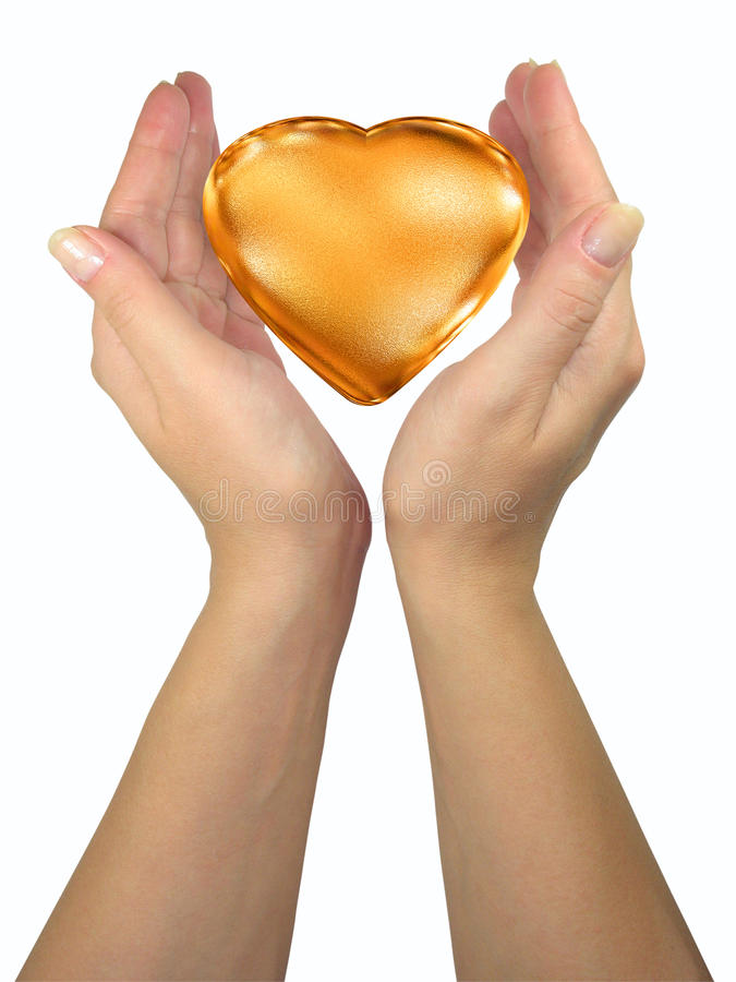 Human lady hands holding golden heart royalty free stock photos