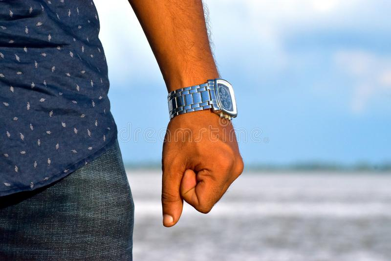 Human Left Hand Wearing a Wrist Watch Stock Photograph. The left hand wearing a nice wrist watch captured in outdoor royalty free stock photograph royalty free stock images
