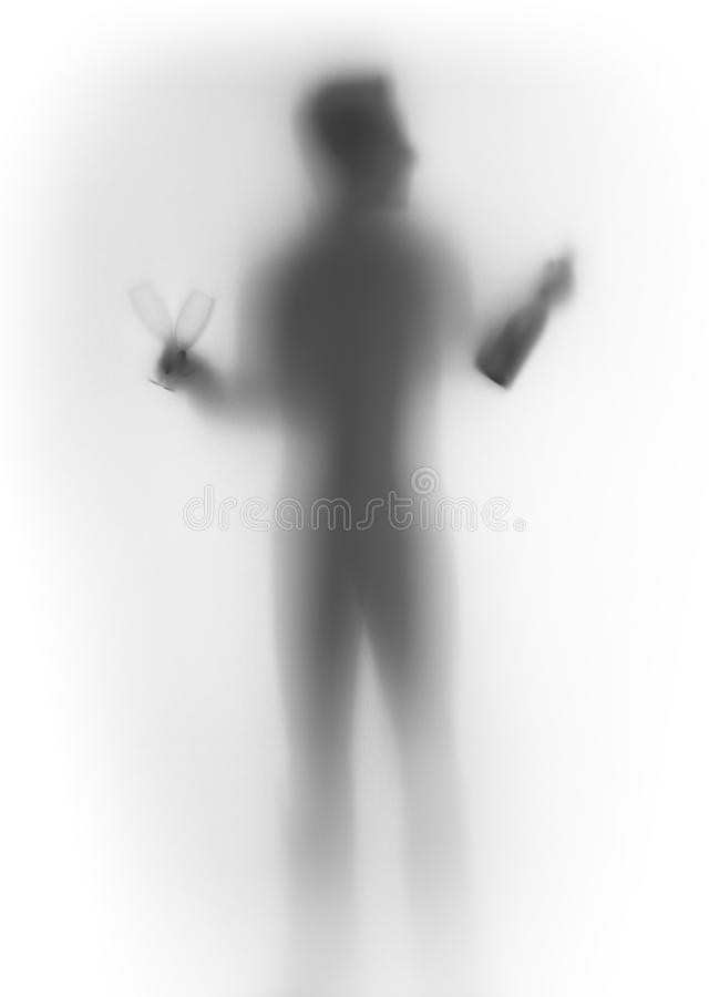 Human male body silhouette, with bottle and glasses. Standing man body with a pair of glasses and bottle behind a curtain stock photo