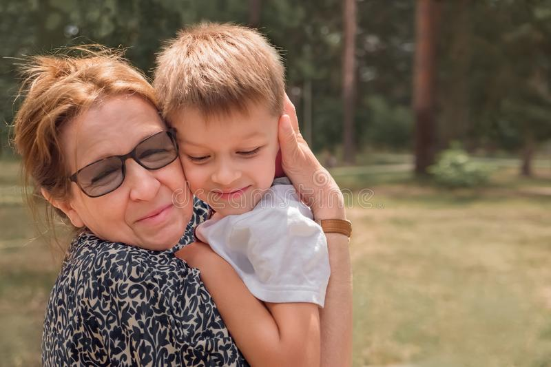 Human and nature. Generic relationship. Happy family background. Family background. Grandmother with her grandson embracing firmly. Emotional people. Family stock photos