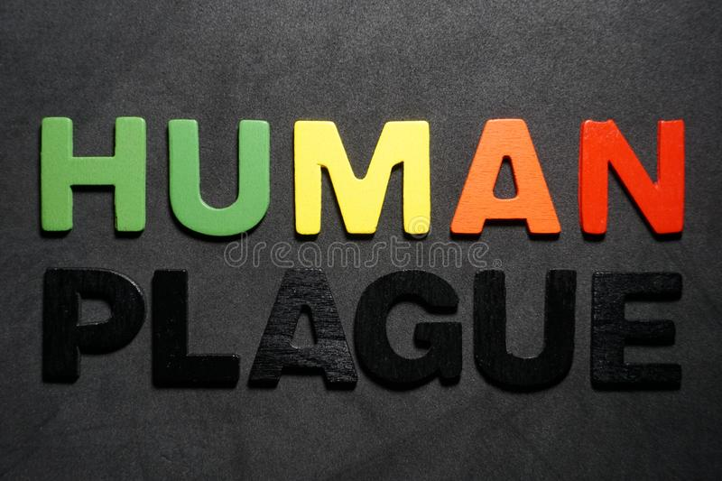 Human plague. Word colorful letter text on black and grey background illustration creative type graphic message expression pedro jose pedryj stock photography