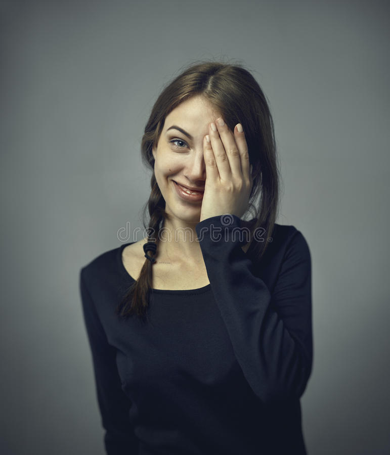 Human positive emotions and feelings. Headshot of cute attractive young European female covering open mouth with hand and closing stock photo