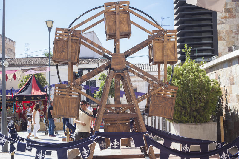 Human powered wooden ferris wheel. Badajoz, Spain - September 24, 2016: Human powered wooden ferris wheel operated by hand at Almossasa Medieval Festival royalty free stock image