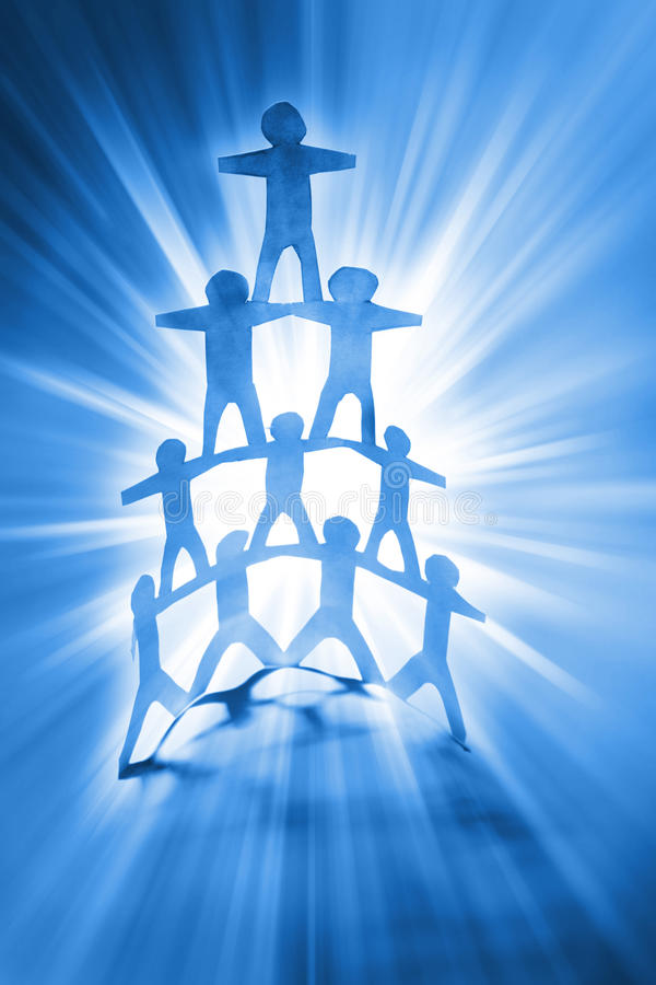 Human pyramid. Human team pyramid on bright blue background stock image