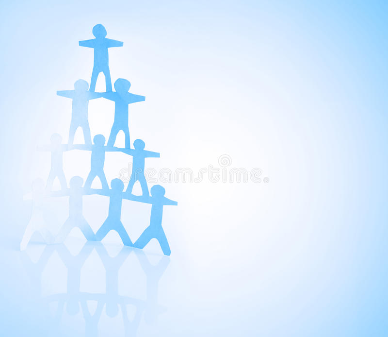 Human pyramid. Human team pyramid on blue background royalty free stock photos