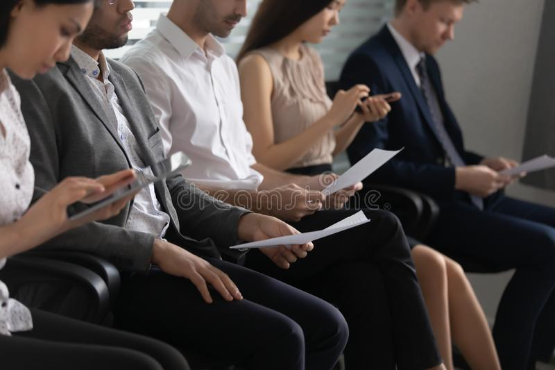 Human resource concept, diverse business people applicants sit in row royalty free stock photo