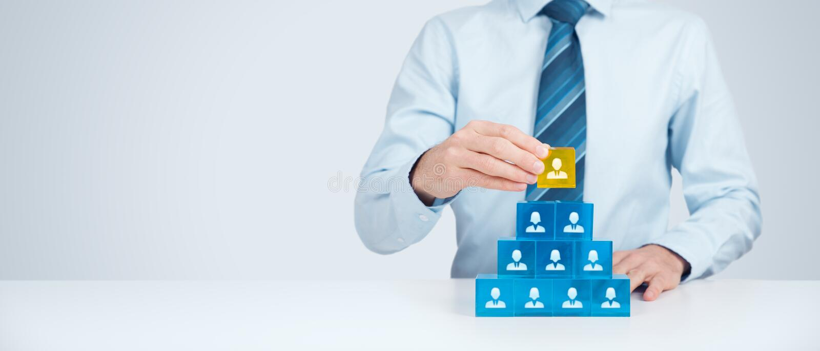 Human resources and CEO. Human resources and corporate hierarchy concept - recruiter complete team by one leader person (CEO) represented by gold cube and icon royalty free stock images