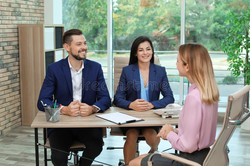 Human resources commission conducting job interview. With applicant in office stock photos