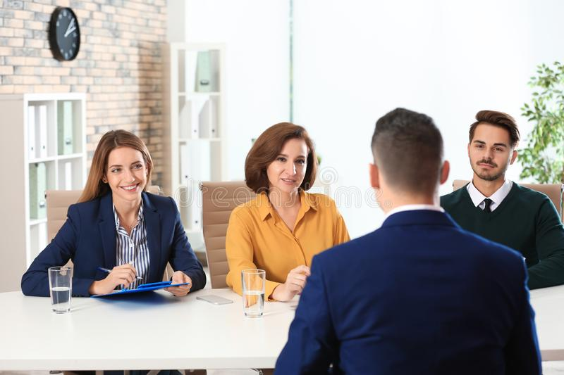 Human resources commission conducting job interview with applicant. In office royalty free stock images