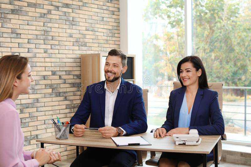 Human resources commission conducting job interview. With applicant in office stock images
