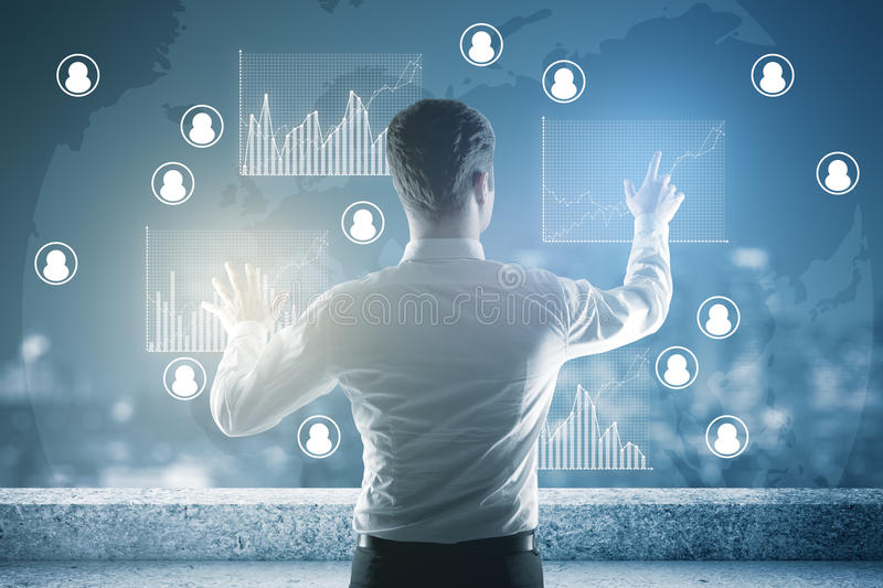 Human resources concept. Back view of young businessman on rooftop managing business charts. Human resources concept royalty free stock photography