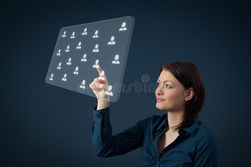 Human resources and CRM. Human resources, CRM and social networking concept - female officer choose person (employee) displayed on futuristic virtual screen stock images