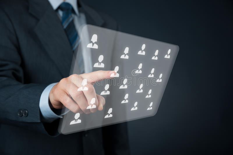 Human resources and CRM. Human resources, CRM and social networking concept - officer choose person (employee) displayed on futuristic virtual screen stock images