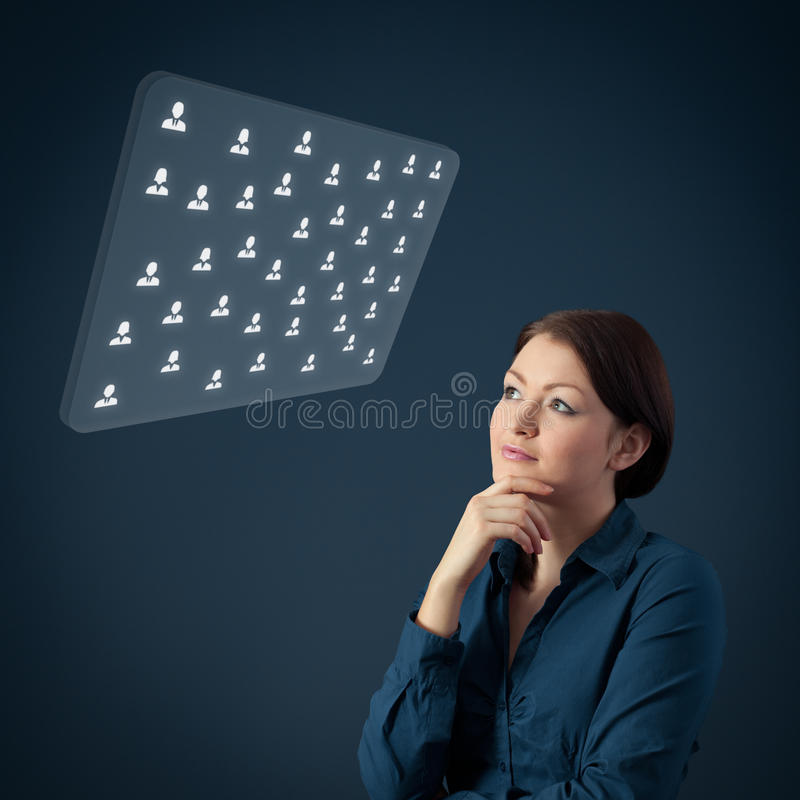 Human resources HR. Human resources female officer think about new candidates or team structure displayed on futuristic virtual screen. Marketing specialist stock images
